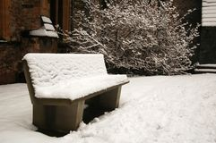 Bench at the Cardiff cathedral. Covered by snow royalty free stock photo