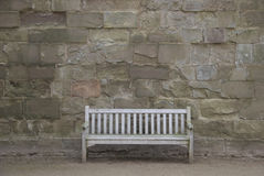 Bench in castle courtyard Royalty Free Stock Image