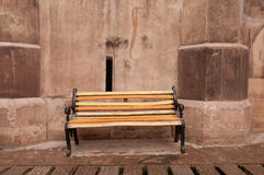 Bench in castle courtyard. A wooden bench in the courtyard of a medieval castle (Hunedoara Castle) in Romania stock photography