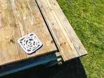 Bench and ceramic cup base. Wood royalty free stock images