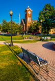 Bench and a church on the town square in New Oxford, Pennsylvani Stock Images