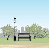 Bench in city park cityscape. Garden landscape.  City skyline Stock Photo