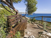 Bench on a Cliff. Wooden bench on a cliff facing to the Mediterranean sea Stock Photography