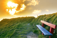 Bench on a cliff edge with sunset Royalty Free Stock Photo