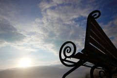 Bench on the cliff of the sea. royalty free stock photography