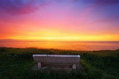 Bench on cliff at sunset Royalty Free Stock Photos