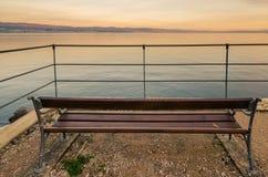 Bench on the coast Stock Image