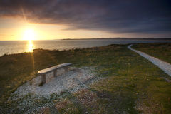 Bench coastal view of sunset Royalty Free Stock Photo