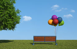 Bench with colorful balloons Stock Photos