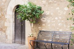Bench in the courtyard of the historical building in Taormina, Sicily, Italy royalty free stock photo