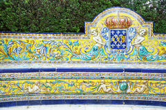 Bench covered with azulejos in Reales Alcazares, Sevilla Royalty Free Stock Images