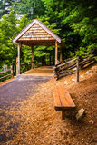 Bench and covered bridge in Helen, Georgia. Royalty Free Stock Photo