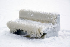 Bench covered with ice Stock Images