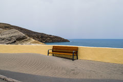 Bench covered with the sand, beach at Tenerife, Canary islands Royalty Free Stock Photos