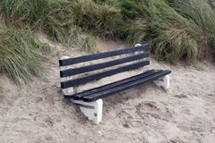 Bench covered in sand Stock Images
