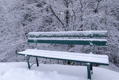 Snowy bench Royalty Free Stock Photography