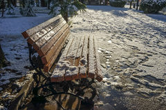 Bench covered with snow on the embankment South Royalty Free Stock Image