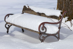 Bench covered in snow Royalty Free Stock Photos