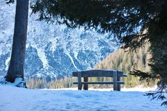 Bench covered with snow, Italy. Bench covered with snow in front of Braies Lake in Alto-Adige, Dolomites, Italy Stock Images