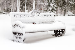 Bench covered by snow Royalty Free Stock Image