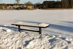 Bench covered with snow Stock Images