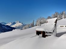 Bench covered with snow Royalty Free Stock Photos