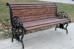 Bench with curly armrests royalty free stock photo