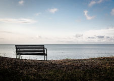 Bench on a Curonian Lagoon shore Stock Images