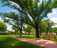 Bench before the curve. A bright sunny day at Liberty park in Plantation Florida Stock Images
