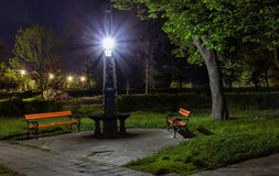 Bench in a dark park Stock Image