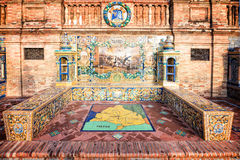Bench decorated with azulejos on Plaza de Espana (Spain square) in Seville Royalty Free Stock Image