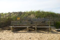 The Bench on Ditch Plains beach Montauk New York with erosion co. Surfer`s `The Bench` on Ditch Plains Beach Montauk, New York, The Hamptons with erosion control royalty free stock photos