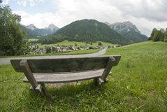Bench on the Dolomites Mountains, Italy Royalty Free Stock Photography