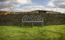 Bench and Dry-Stone Wall. Cotswolds, UK Royalty Free Stock Images