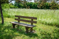 French countryside - Lorraine. A bench at the edge of the road somewhere in Lorraine Royalty Free Stock Photo