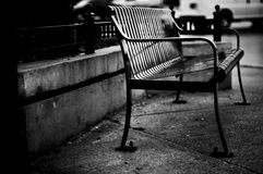 Bench. An empty bench, black and white Royalty Free Stock Image