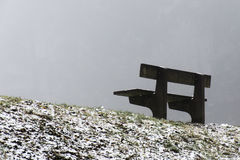 Bench empty seat in wood trees winter and fog 13 Royalty Free Stock Photography