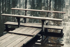 Bench on the end of floating pier Royalty Free Stock Photos