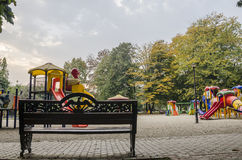 Bench facing playground Stock Images