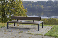 Bench with fall leaves and autumn backround  - stock image Stock Photos