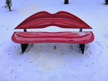 Bench female lips, bench kiss in the winter park of the city royalty free stock photo