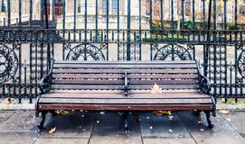 Bench and fence in London, United Kingdom royalty free stock image