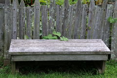 The bench by the fence. Royalty Free Stock Photography