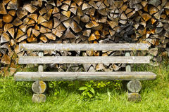Bench and Firewood Stock Photo