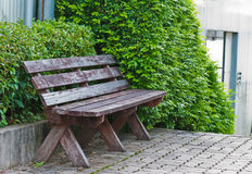 Bench in the flower garden. Bench in the flower garden with Brick floor pathway Royalty Free Stock Photos