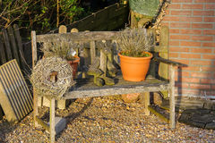 Bench with flower pots, figure of rabbit and a wreath decorated Stock Images