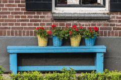 Bench with Flowers in Basket Stock Photo