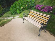 Bench in the flowers garden. Picture of a bench in the flowers garden Royalty Free Stock Image