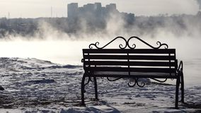 Bench in the fog on the background of the city. stock video
