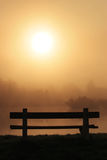 Bench on a foggy morning Royalty Free Stock Photos